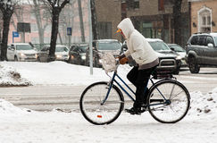 Woman on the bicycle in winter Royalty Free Stock Images