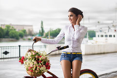 Woman with bicycle Royalty Free Stock Photography