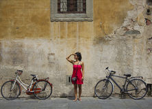 Woman with bicycles Stock Photo