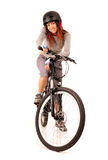 Woman bicyclist. Young smiling woman bicyclist isolated on white Stock Photo