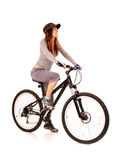 Woman bicyclist. Young smiling woman bicyclist isolated on white Stock Photography