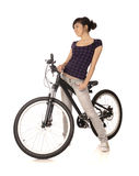 Woman bicyclist Stock Images