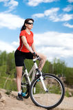 Woman bicyclist Royalty Free Stock Image