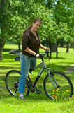 Woman bicyclist on the bike Stock Photo