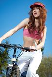 Woman on a bicykle outdoors smiling Royalty Free Stock Photo