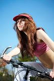 Woman on a bicykle outdoors smiling Royalty Free Stock Images