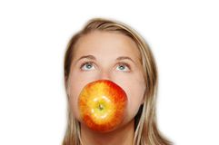 Woman with a big apple in mouth Royalty Free Stock Photos