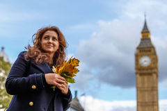 Woman and Big ben in the autumn Stock Photos