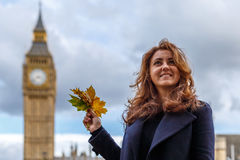 Woman and Big ben in the autumn Royalty Free Stock Photos