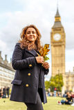 Woman and Big ben in the autumn Stock Image