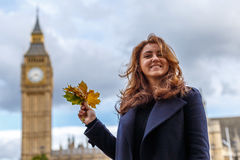 Woman and Big ben in the autumn Stock Images
