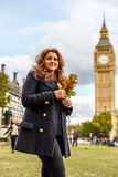 Woman and Big ben in the autumn Stock Photo