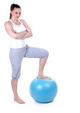 Woman with big blue ball Stock Photography