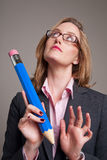 Woman with a big blue pencil Stock Images