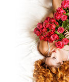 Woman with big bouquet of red roses Stock Images