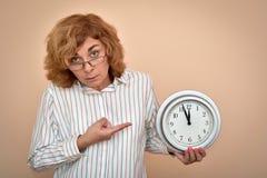Woman with a big clock stock photos
