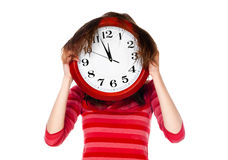 Woman with big clock covering face Stock Photography