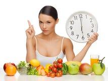 Woman with big clock Stock Photos