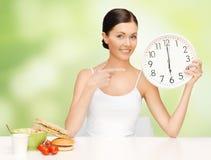 Woman with big clock Stock Photo