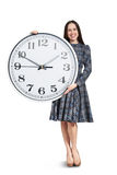 Woman with big clock posing Royalty Free Stock Photography