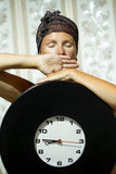 Woman with big clock sitting in the room. Royalty Free Stock Images
