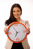 Woman with big clock smiling prepared on time. Stock Photography
