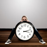 Woman with a big clock: Time Concept Stock Image
