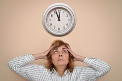 Woman with a big clock stock photography