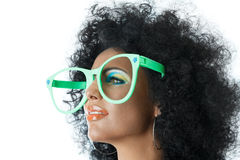 Woman in big clown glasses. Woman with curly hair and big clown glasses Royalty Free Stock Images