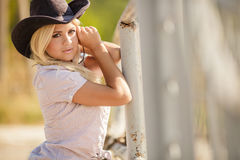 The woman in a big cowboy's hat on the ranch Royalty Free Stock Image