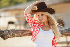The woman in a big cowboy's hat on the ranch Stock Photos