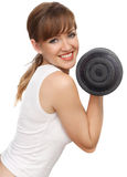 Woman with a big dumbbell. On a white background Stock Image