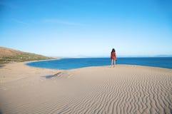 Woman big dune and sea Royalty Free Stock Photography