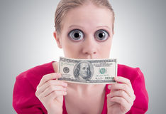 Woman with a big eyes and mouth closed dollar. Money concept. woman with a big surprise open eyes and mouth closed dollar Royalty Free Stock Image