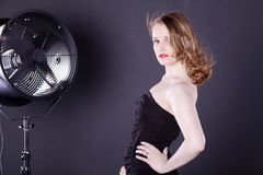 Woman with big fan Royalty Free Stock Images
