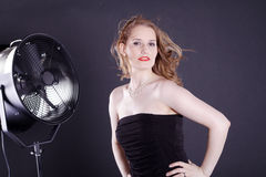 Woman with big fan Royalty Free Stock Photo