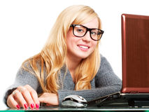 Woman in big glasses working on computer Royalty Free Stock Images