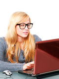 Woman in big glasses working on computer Stock Photo