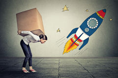 Woman with big goals carrying large box. Career challenge target concept Royalty Free Stock Photography