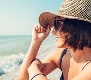 Woman in big hat  enjoyes with sea view Stock Images