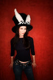 Woman in big hat with rabbit ears Royalty Free Stock Images