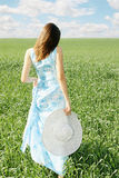 Woman with a big hat Royalty Free Stock Image