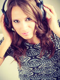 Woman in big headphones listening music mp3 relaxing Stock Photos