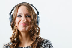 Woman in big headphones listening music mp3 relaxing Royalty Free Stock Photos