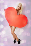 Woman with big heart Stock Image