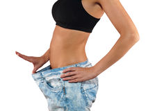 Woman with big jeans weight loss Stock Photography