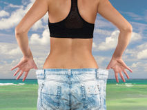 Woman with big jeans weight loss Royalty Free Stock Photo