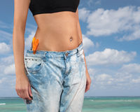 Woman with big jeans weight loss Stock Photos