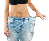Woman with big jeans weight loss Royalty Free Stock Images