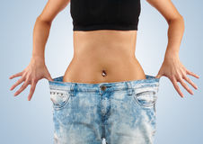 Woman with big jeans weight loss Royalty Free Stock Image